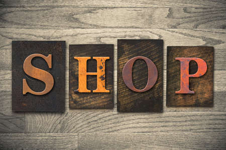 emporium: The word SHOP written in wooden letterpress type. Stock Photo