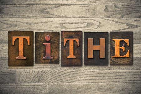 The word TITHE written in wooden letterpress type.