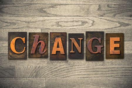 amend: The word CHANGE written in wooden letterpress type.
