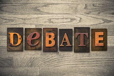 The word DEBATE written in wooden letterpress type.