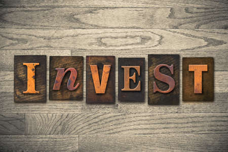 bankroll: The word INVEST written in wooden letterpress type.