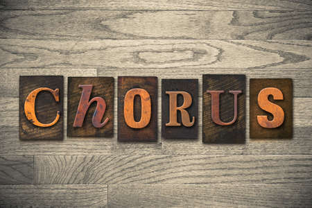 The word CHORUS written in wooden letterpress type.
