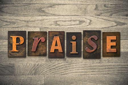praised: The word PRAISE written in wooden letterpress type.