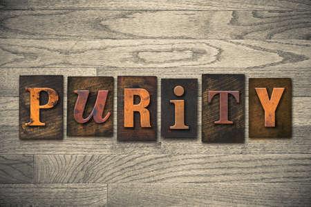 purity: The word PURITY written in wooden letterpress type.