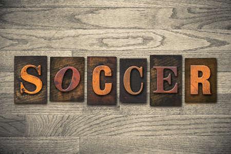 letterpress: The word SOCCER written in wooden letterpress type.