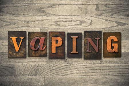 The word VAPING written in vintage wooden letterpress type.
