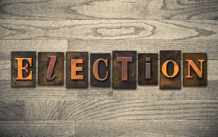 elected: The word ELECTION written in vintage wooden letterpress type.
