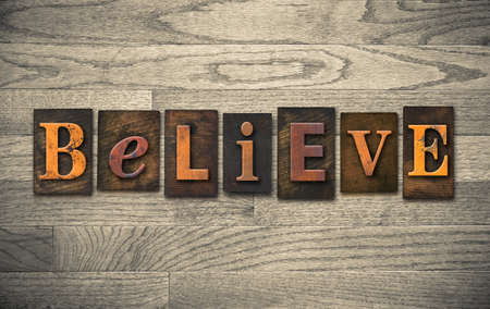 The word BELIEVE written in vintage wooden letterpress type.