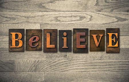 letterpress: The word BELIEVE written in vintage wooden letterpress type.