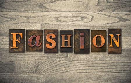 The word FASHION written in vintage wooden letterpress type.