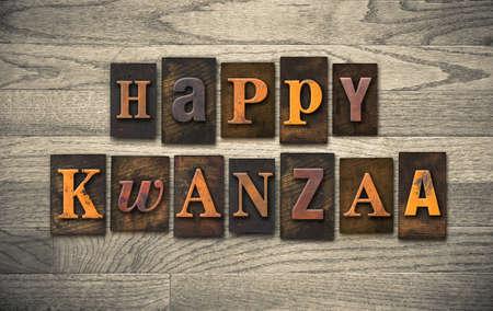letterpress: The words HAPPY KWANZAA written in vintage wooden letterpress type.
