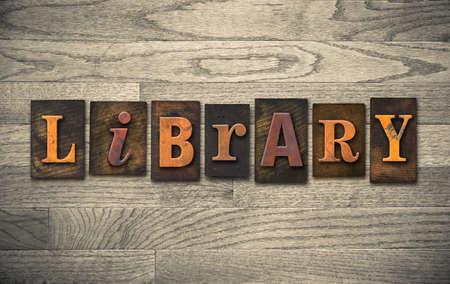 letterpress letters: The word LIBRARY written in vintage wooden letterpress type.