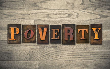 impoverish: The word POVERTY written in vintage wooden letterpress type.