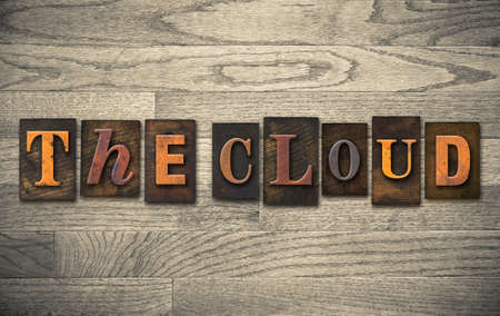 syncing: The words THE CLOUD written in vintage wooden letterpress type. Stock Photo
