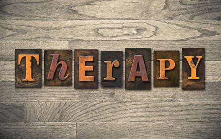 therapeutics: The word THERAPY written in vintage wooden letterpress type. Stock Photo