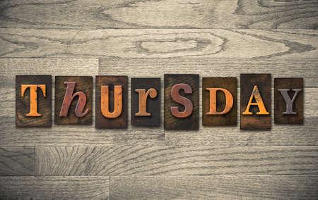 "The word ""THURSDAY"" written in vintage wooden letterpress type."