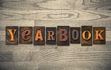 homecoming: The word YEARBOOK written in vintage wooden letterpress type.