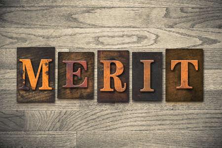 merit: The word MERIT written in vintage wooden letterpress type.