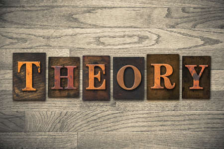 theorize: The word THEORY written in vintage wooden letterpress type.