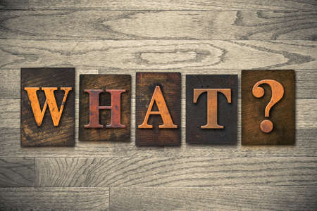 The word WHAT? written in vintage wooden letterpress type. photo