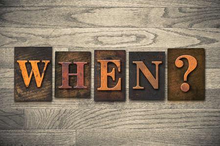 The word WHEN? written in vintage wooden letterpress type. photo