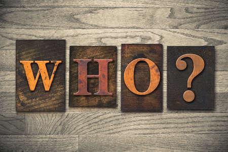 The word WHO? written in vintage wooden letterpress type. photo