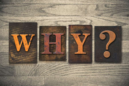 The word WHY? written in vintage wooden letterpress type. photo