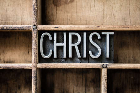The name CHRIST written in vintage metal letterpress type sitting in a wooden drawer.