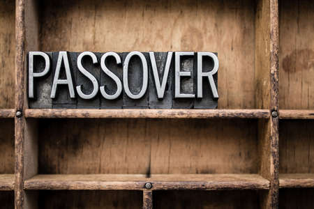 jesus word: The word PASSOVER written in vintage metal letterpress type in a wooden drawer with dividers.