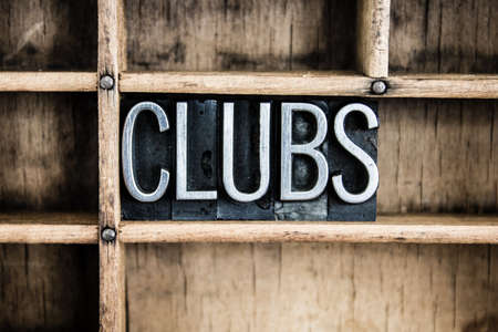 strip club: The word CLUBS written in vintage metal letterpress type in a wooden drawer with dividers. Stock Photo