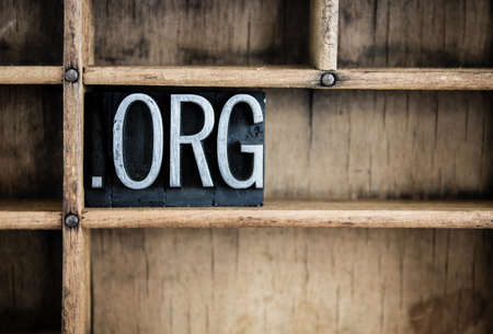 org: The abbreviation DOT ORG written in vintage metal letterpress type in a wooden drawer with dividers.