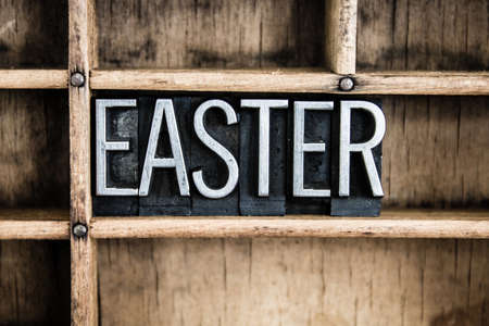 palm sunday: The word EASTER written in vintage metal letterpress type in a wooden drawer with dividers.