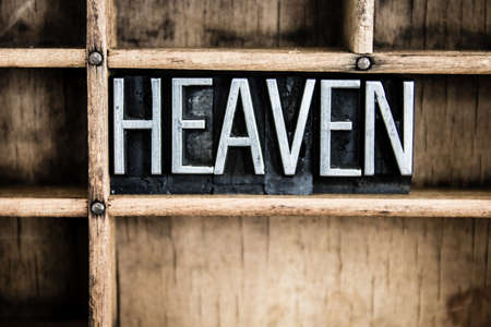 promised: The word HEAVEN written in vintage metal letterpress type in a wooden drawer with dividers.