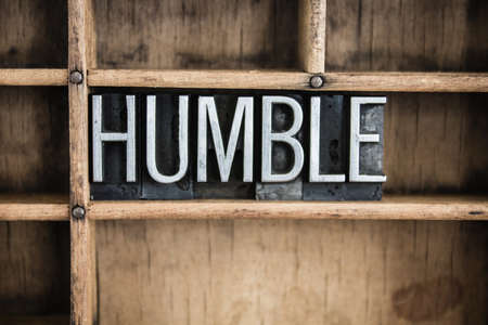 The word HUMBLE written in vintage metal letterpress type in a wooden drawer with dividers.