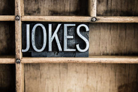 farce: The word JOKES written in vintage metal letterpress type in a wooden drawer with dividers. Stock Photo