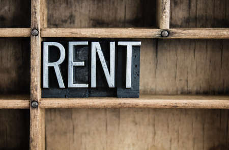rented: The word RENT written in vintage metal letterpress type in a wooden drawer with dividers.