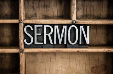 The word SERMON written in vintage metal letterpress type in a wooden drawer with dividers.