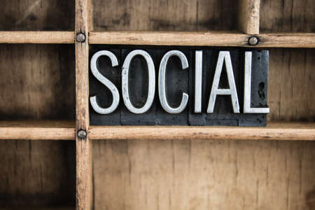 socially: The word SOCIAL written in vintage metal letterpress type in a wooden drawer with dividers.