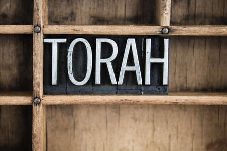 talmud: The word TORAH written in vintage metal letterpress type in a wooden drawer with dividers.
