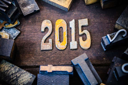 The year 2015 written in rusted metal letters surrounded by vintage wooden and metal letterpress type. photo