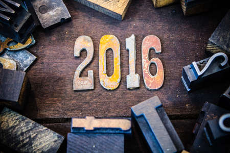 The year 2016 written in rusted metal letters surrounded by vintage wooden and metal letterpress type. photo