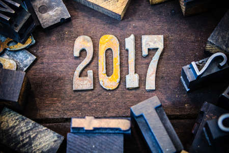The year 2017 written in rusted metal letters surrounded by vintage wooden and metal letterpress type. photo