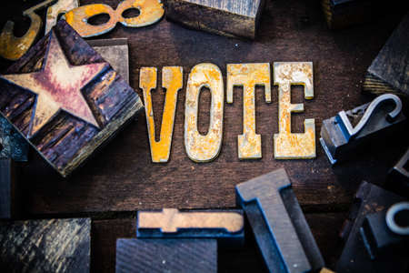 polling booth: The word VOTE written in rusted metal letters surrounded by vintage wooden and metal letterpress type.