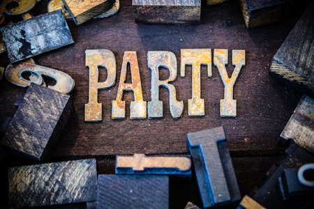 letterpress letters: The word PARTY written in rusted metal letters surrounded by vintage wooden and metal letterpress type.