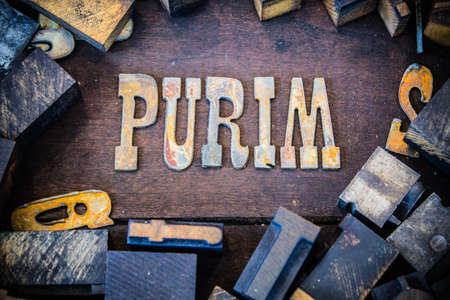 letterpress letters: The word PURIM written in rusted metal letters surrounded by vintage wooden and metal letterpress type.