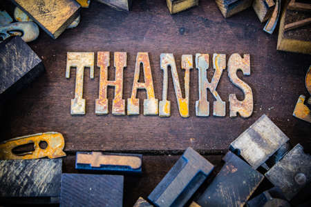 letterpress letters: The word THANKS written in rusted metal letters surrounded by vintage wooden and metal letterpress type.