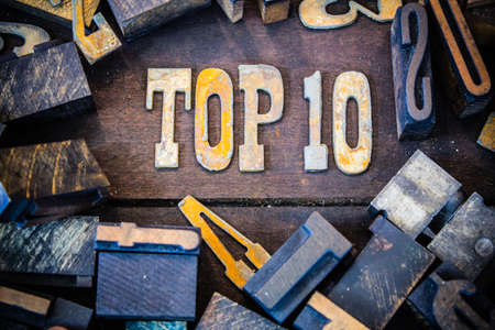 top 10: The words TOP 10 written in rusted metal letters surrounded by vintage wooden and metal letterpress type.