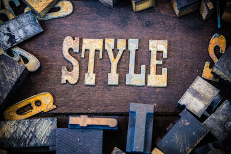letterpress letters: The word STYLE written in rusted metal letters surrounded by vintage wooden and metal letterpress type. Stock Photo