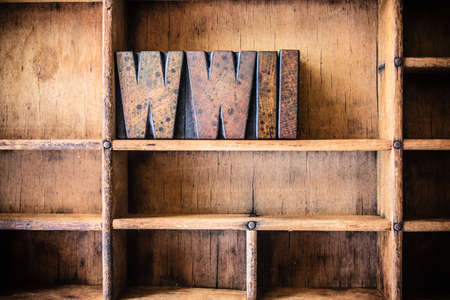 The word WWII written in vintage wooden letterpress type in a wooden type drawer. Stock Photo