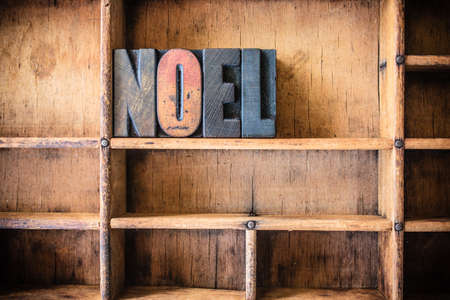 hymn: The word NOEL written in vintage wooden letterpress type in a wooden type drawer. Stock Photo